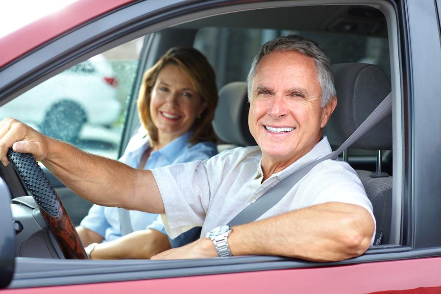 Elderly couple in car.