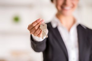 Realtor is giving the keys to an apartment to clients.